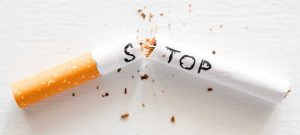 broken cigarette with the word stop. stop smoking concept closeup